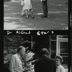 Alfred Etter speaking with man and woman outside, contact sheet
