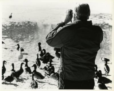 Alfred Etter observing ducks & geese on Arbor Lake in winter