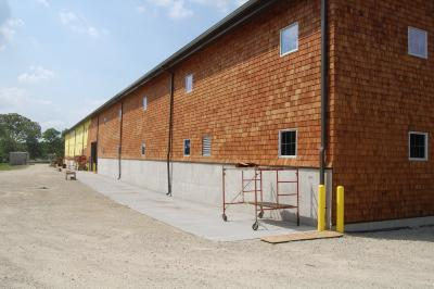 Shingle Siding being added on the new Vehicle Storage Building
