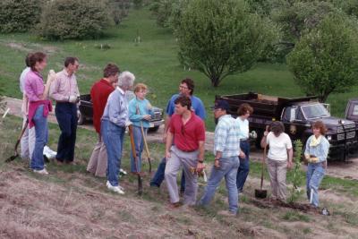 Arboretum employees gathered for tree planting