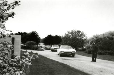 Cop directing traffic at entrance of Arboretum