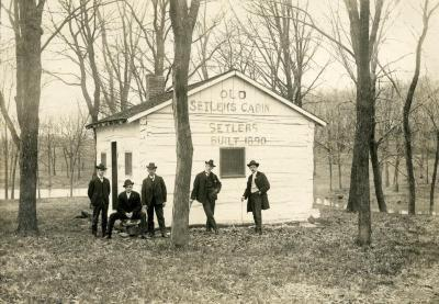 Five men standing in front of Old Setlems Cabin