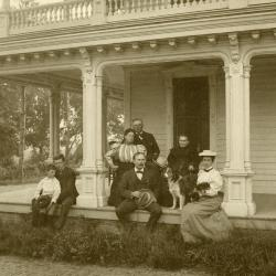 Morton family seated on porch outside of Arbor Lodge