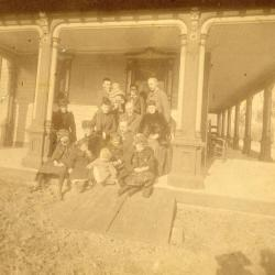 J. Sterling Morton, 4 sons and extended family sitting on Arbor Lodge porch