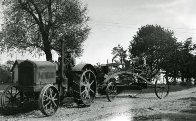 Fist Arboretum tractor pulling remodeled horse-drawn grader