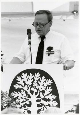 Charles Haffner III speaking at podium for Arboretum event