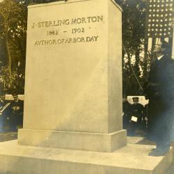 Memorial dedication in honor of J. Sterling Morton at Arbor Lodge, engraving below statue