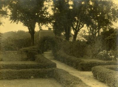 Arbor Lodge gardens and surrounding landscape, walking path along pruned hedges
