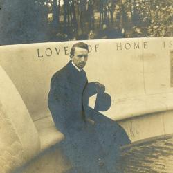 Memorial dedication in honor of J. Sterling Morton at Arbor Lodge, man sitting on curved bench