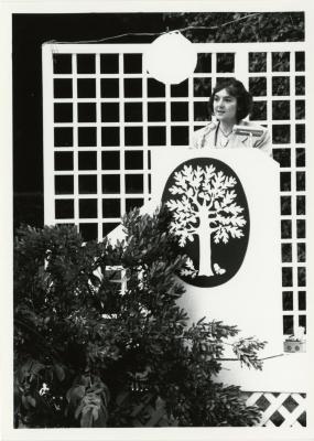 Marilyn Halperin speaking at podium at volunteer recognition evening