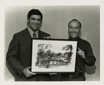 Richard Fitzgerald presenting artwork to Dr. Marion Hall