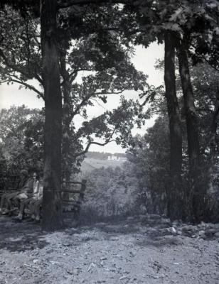 Ridge Road lookout looking west/northwest, children on bench to left, farm buildings in distance
