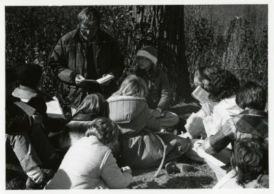 Craig Johnson with school group reading a book outside
