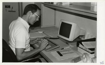 Ed Hedborn at new computer for the Collections department