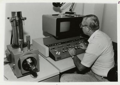 Dr. William Hess using the scanning electron microscope