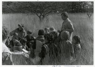 Craig Johnson with school group in tall grass