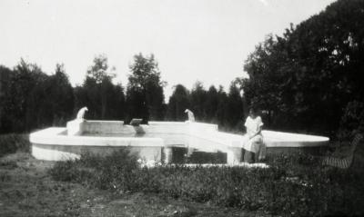 Morton residence at Thornhill, woman sitting at pool