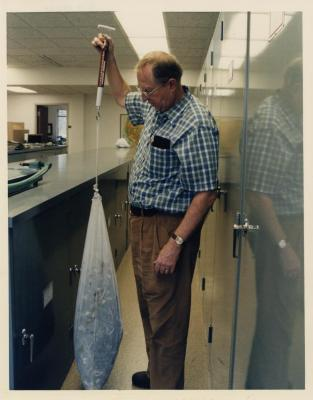 Dr. William Hess weighing anti-cancer plants