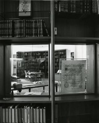 Sterling Morton Library, reading room, view of center through curved bookshelf glass window