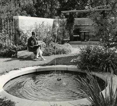 May T. Watts Reading Garden, Suzette Morton Zurcher seated near fountain