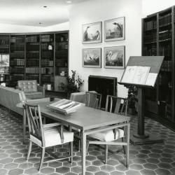 Sterling Morton Library, reading room, displays on tables and easel before fireplace