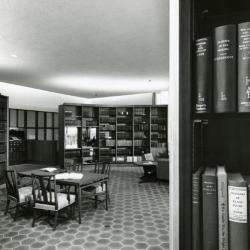 Sterling Morton Library, reading room, center table and curved bookshelves