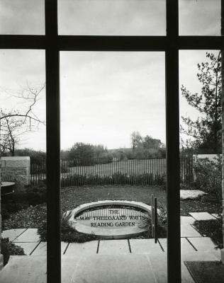 Sterling Morton Library, view into May Theilgaard Watts Reading Garden through glass door