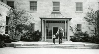 Administration Building, man and child in front of entrance