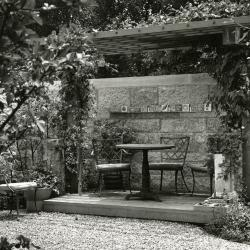 May T. Watts Reading Garden, pergola with clay tiles commemorating botanists along shelf on wall