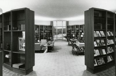 Sterling Morton Library, reading room, through curved bookshelves toward Reading Garden