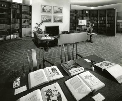Sterling Morton Library, reading room, fireplace reading area, study table with display of books in foreground