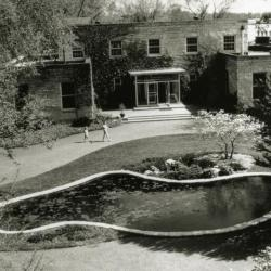Administration Building front entrance and lily pond, aerial view