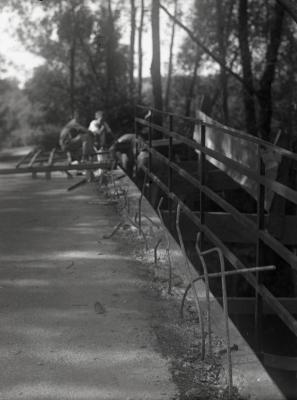 DuPage River bridge, men working on metal railing installation