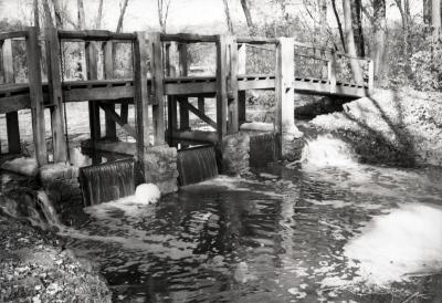 Wooden bridge crossing over DuPage River dam