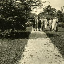 Mrs. Joy Morton and friends, along path in gardens at Thornhill residence