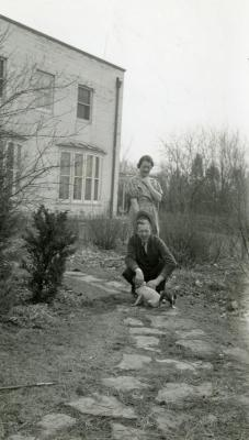 Clarence and Margaret Godshalk outside with several of their puppies