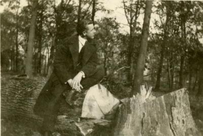 Clarence E. Godshalk sitting on a fallen oak in the woodlands, north of Lake Marmo