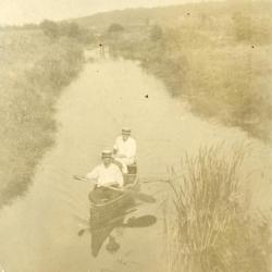 Clarence E. Godshalk and Emil Heineman canoeing on the DuPage River behind his house