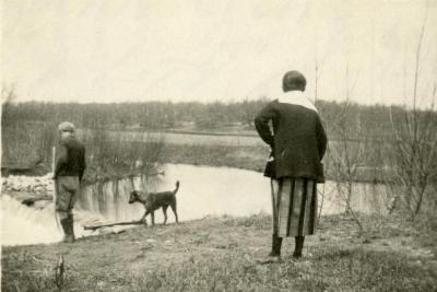 Clarence and Margaret Godshalk with their dog, Punch, at the river dam behind their house