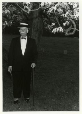 Twilight Tree Walk, Craig Johnson dressed as Joy Morton standing by tree