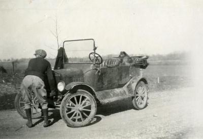 Clarence E. Godshalk and his dog, Punch, with Joy Morton's castoff Model T car
