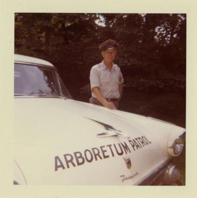 Fred Johnson, with Arboretum Patrol car