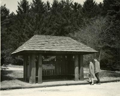 Two people approaching Arboretum Map Station