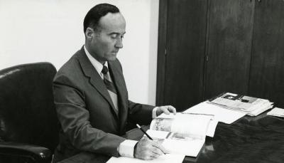Marion T. Hall working at his desk