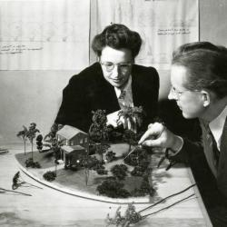 Clarence Godshalk and woman reviewing model in landscape modeling class