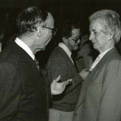 Clarence E. Godshalk's 90th birthday celebration scrapbook: Marion Hall talking with Helen Langrill