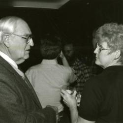 Clarence E. Godshalk's 90th birthday celebration scrapbook: Walter Eickhorst talking with Nancy Eickhorst