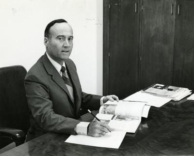 Marion T. Hall at his desk