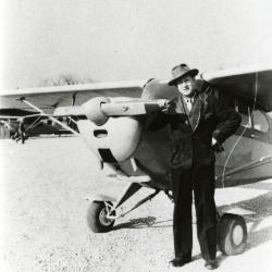 Clarence Godshalk with his airplane