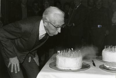 Clarence E. Godshalk's 90th birthday celebration scrapbook: Clarence Godshalk blowing out 90 candles on his birthday cake